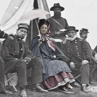 old photo of woman sitting with civil war soldiers