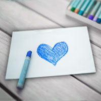 greeting card with a hand-drawn blue heart