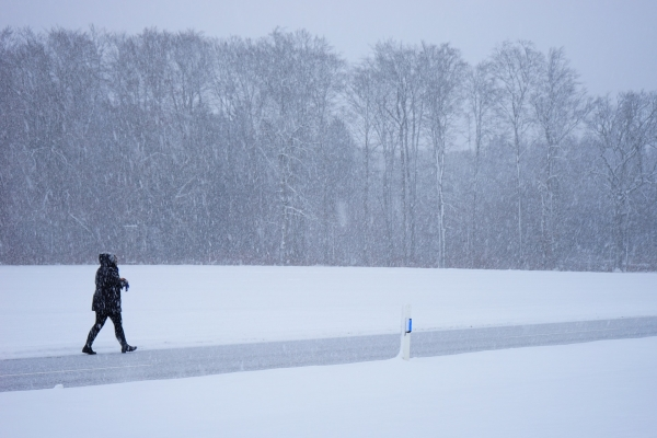 person walking through a blizzard