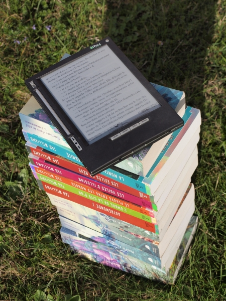 e-reader on a stack of books