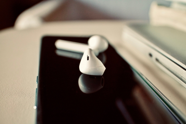 wireless earbuds and a smartphone