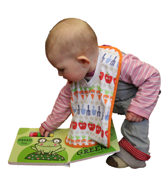 toddler opening a book