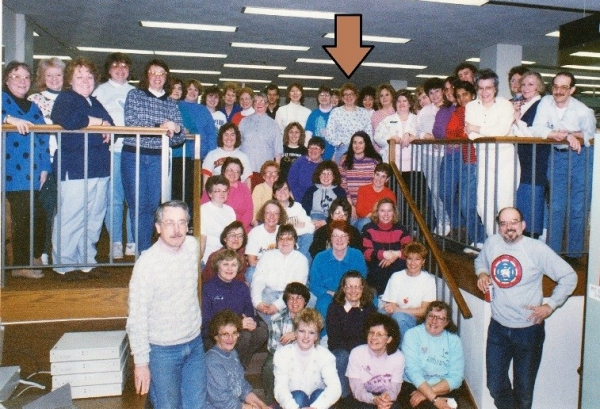 MCPL staff in the early 1980s. Sharyn Heili is pictured under the arrow.