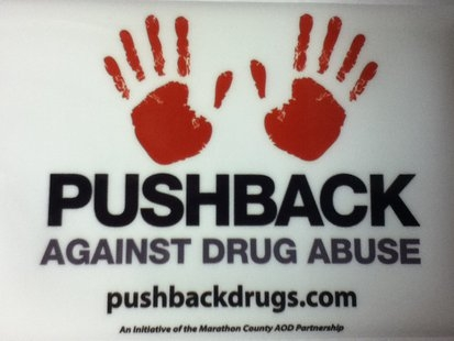 """Pushback against drug abuse"" with red hands"
