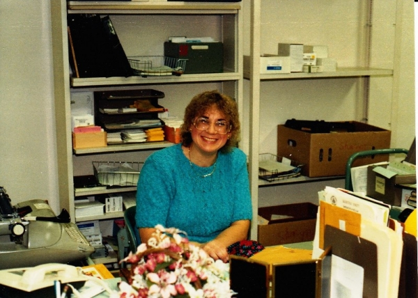 Sharyn Heili at her library reference desk in the mid-1980s.