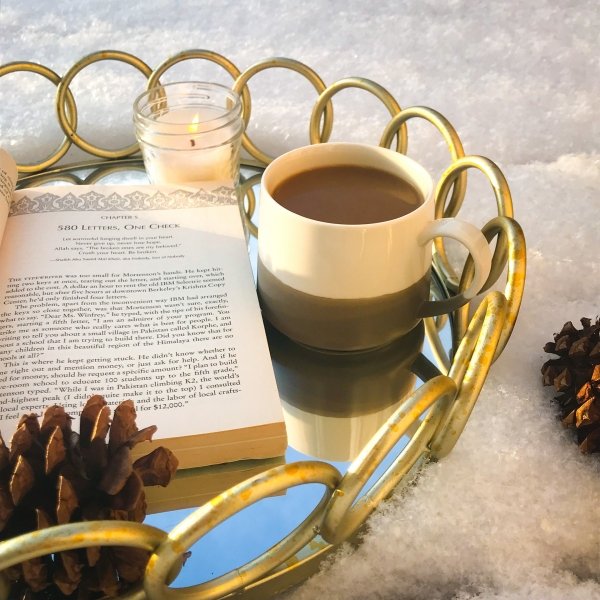 book with cocoa and candle