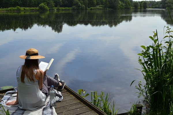 woman reading on a dock