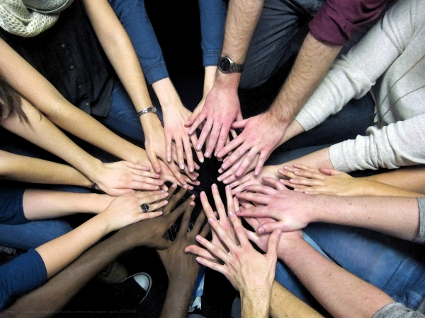 teen hands together to show teamwork