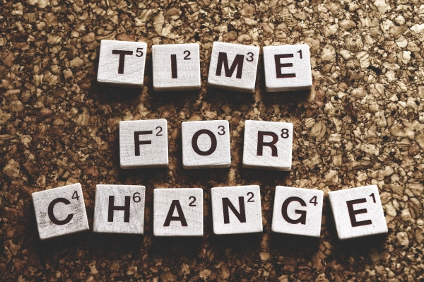 """""""Time for Change"""" spelled with Scrabble letters"""