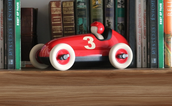 toy car on shelf with books