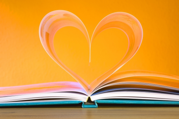 book with pages curled into the shape of a heart