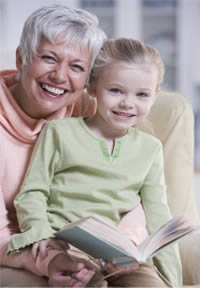 older woman reading to child