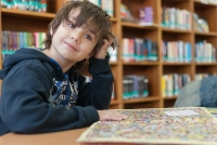 boy in library with book