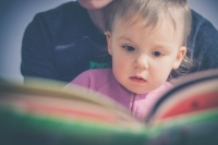 child being read a book