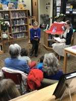 Author Cindy Meyering reads from her book at the Marathon City Branch, 2019