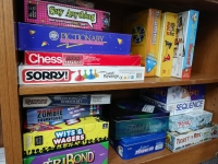 picture of board game shelf in children's at MCPL Wausau