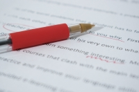 pen on document with proofreading marks