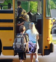 children boarding a bus