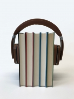 headphones holding a row of books